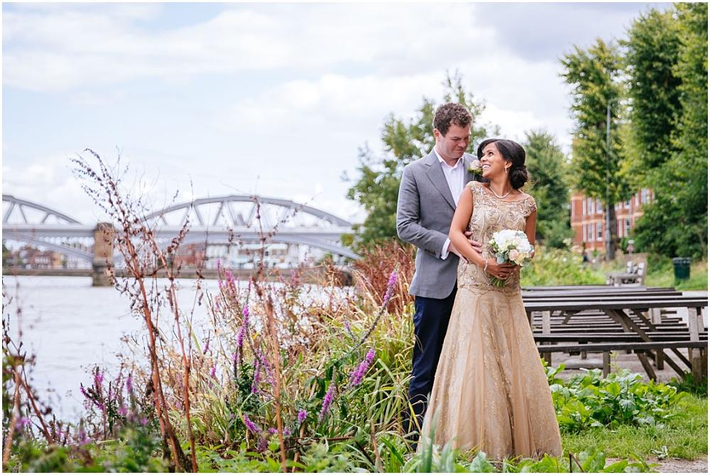 Bride and groom in front of barnes bridge