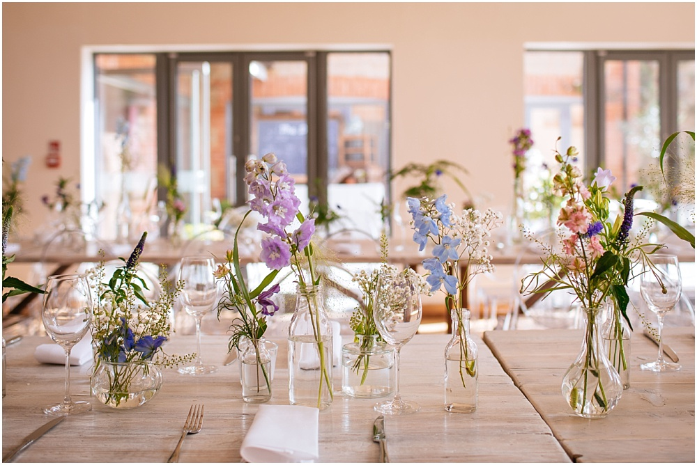 flowers in jars as wedding table decorations