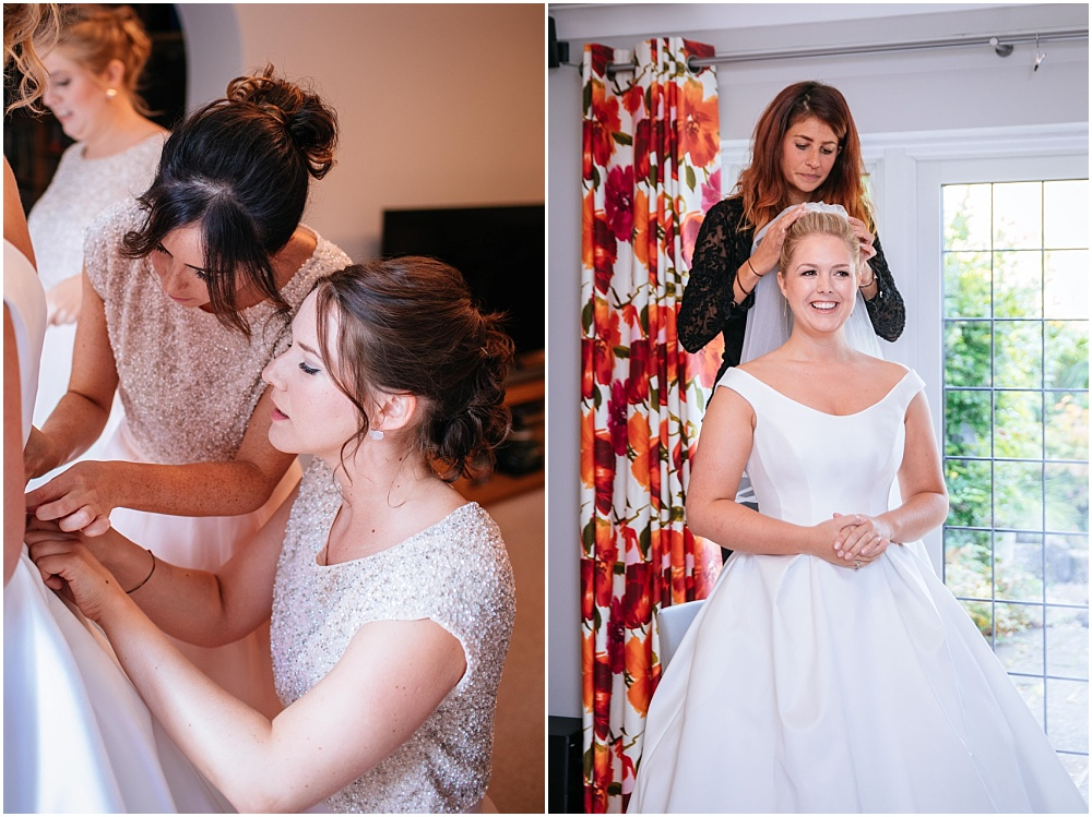 bride gettin into wedding dress