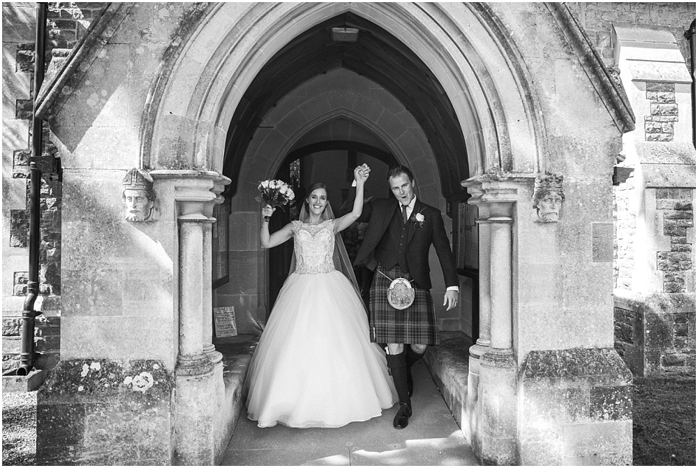 Jubilant newlyweds leave All Saints Church Haslemere