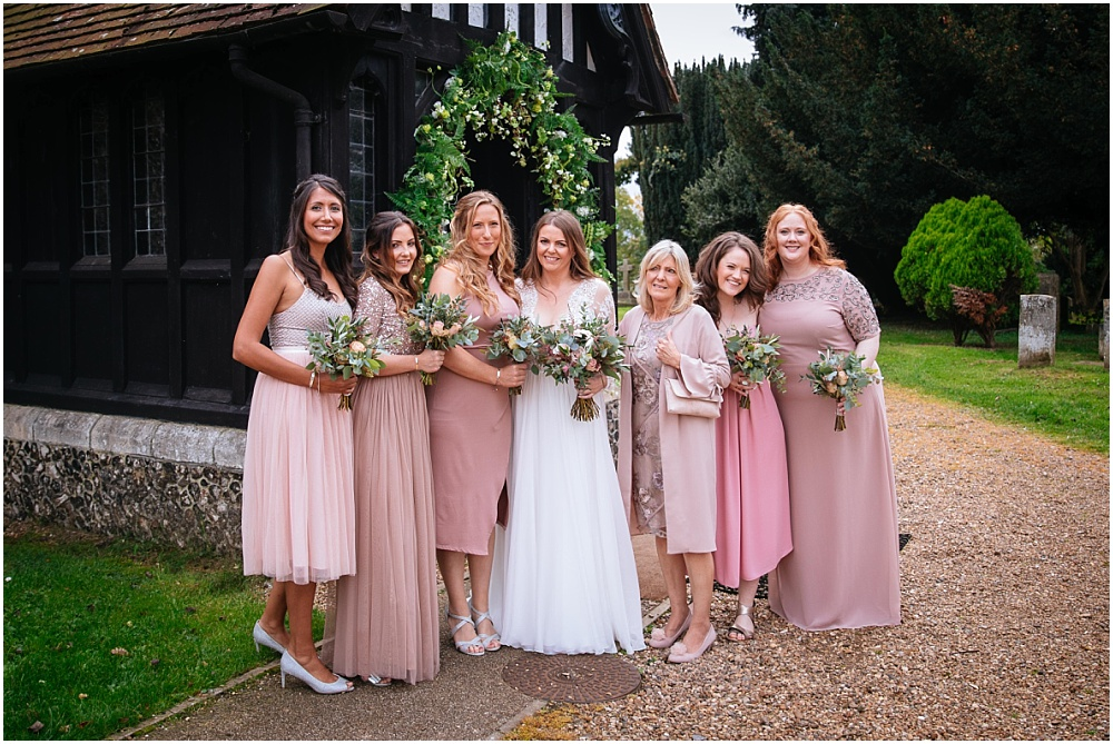 Bridesmaid in different blush dreses