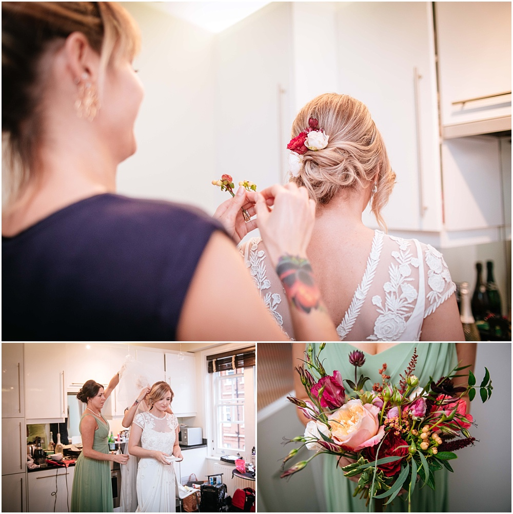 Putting flowers into brides hair at london wedding