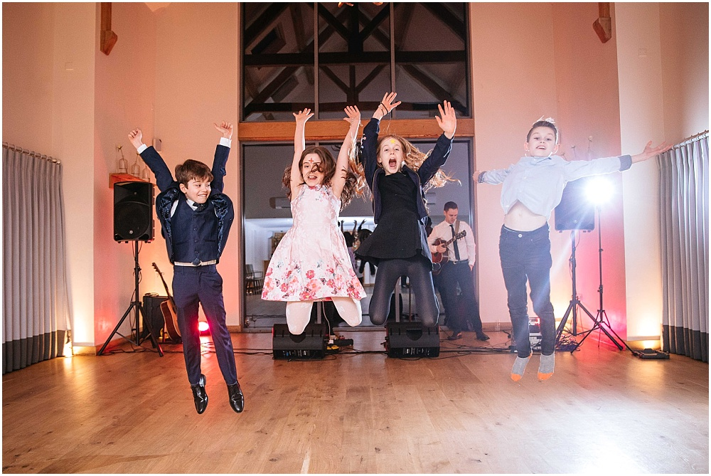 Children jumping at Millbridge court wedding