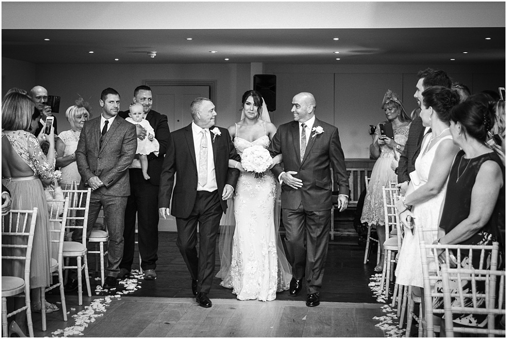 Bride walked down aisle by father and stepfather