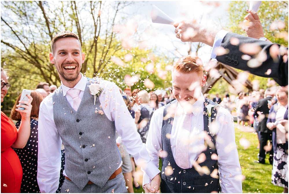 Two grooms and lots of confetti