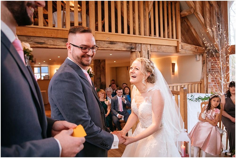 Bride laughing during wedding at bury court barn