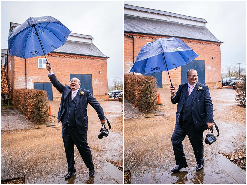 Father dancing with umbrella