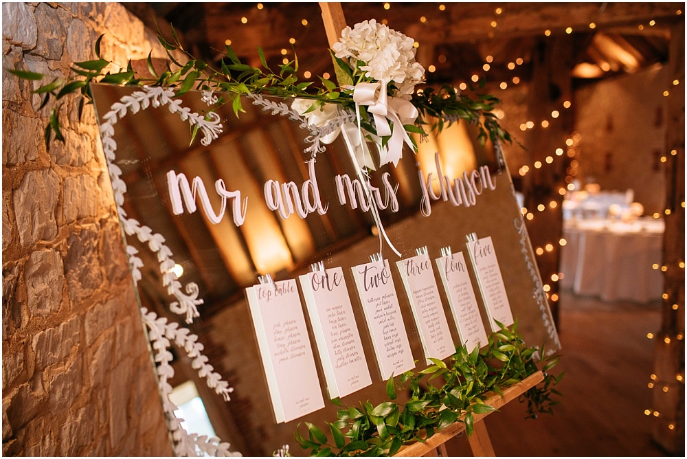 Wedding table plan on mirror with calligraphy