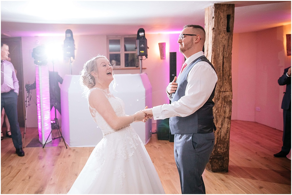 Laughing during first dance at bury court