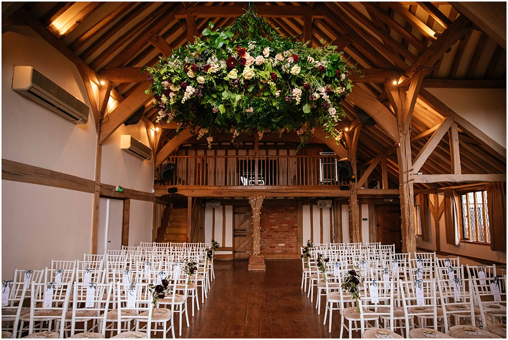 Cain manor set up for ceremony with flower chandelier by Angel Like Flowers