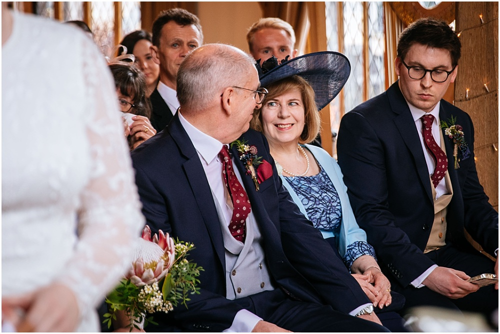 Mother and father exchange glance during wedding ceremony