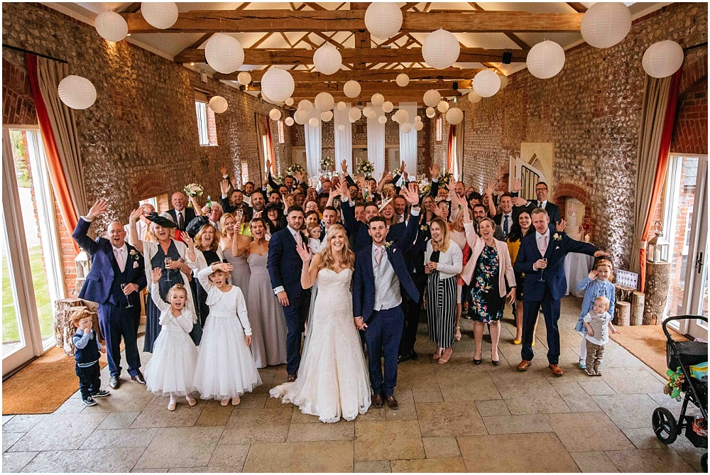Photograph of all wedding guests inside in Farbridge