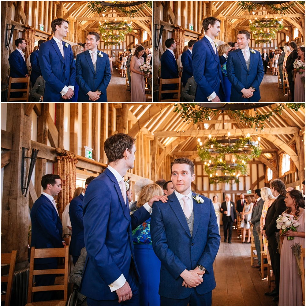 Emotional groom waits for bride at gate street barn