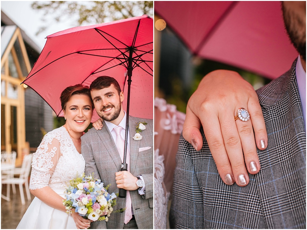 Bride and groom and pink umbrella