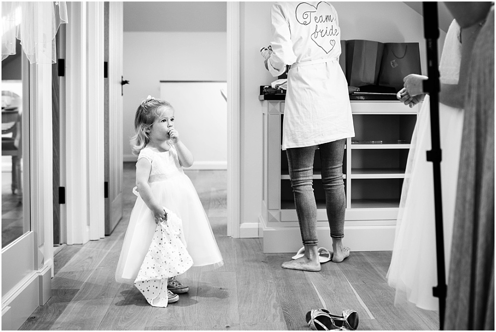 flower girl watches getting ready