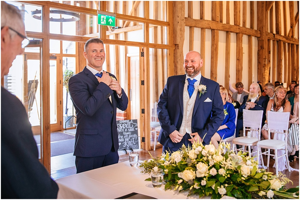 Groom laughing before wedding ceremony