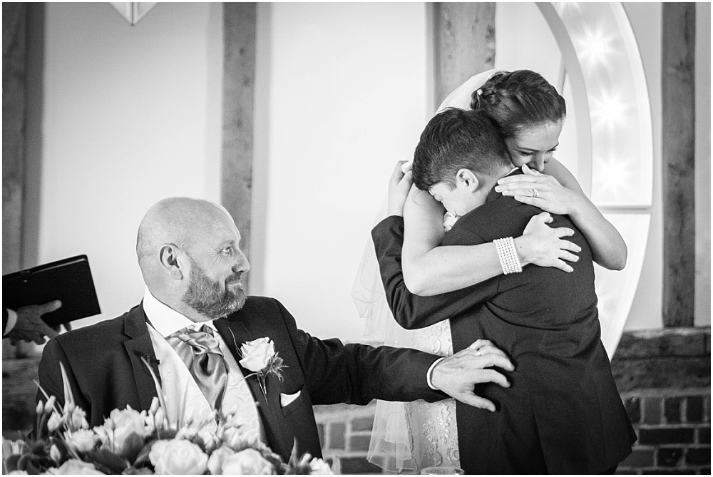 Mum hugs son during wedding