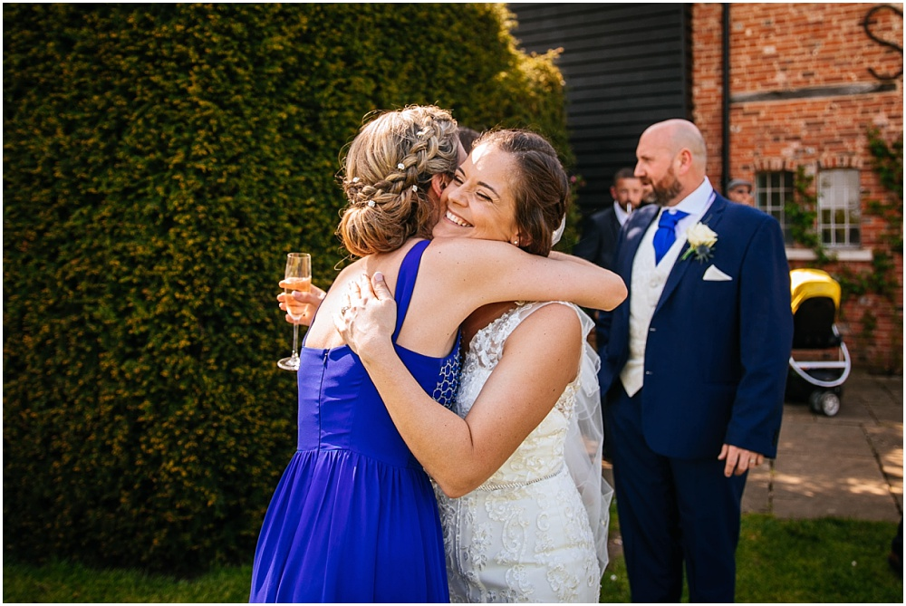 Bride hugs sister
