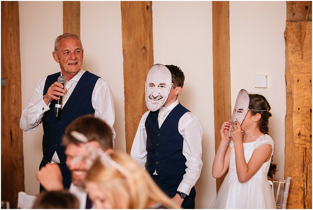 Phil collins mask during wedding speeches