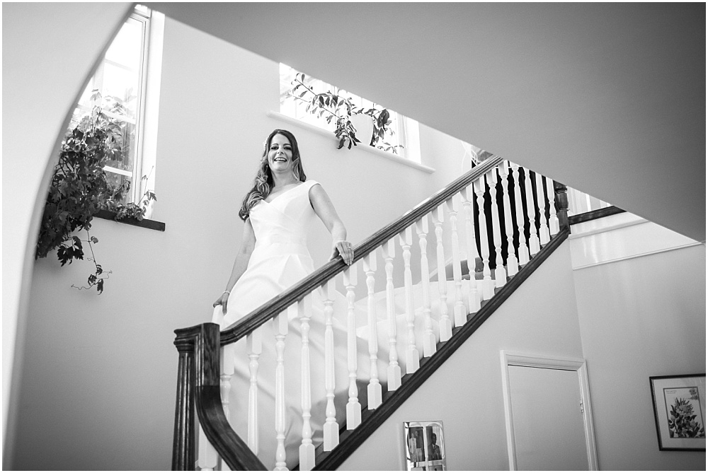 Bride walking down stairs at mothers home