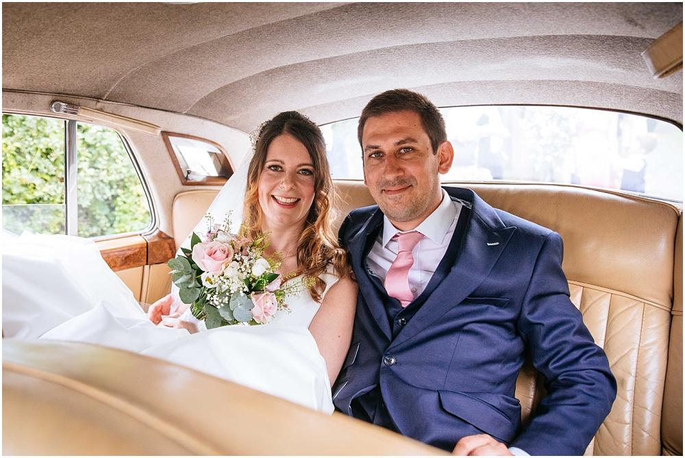 Bride and groom in wedding car