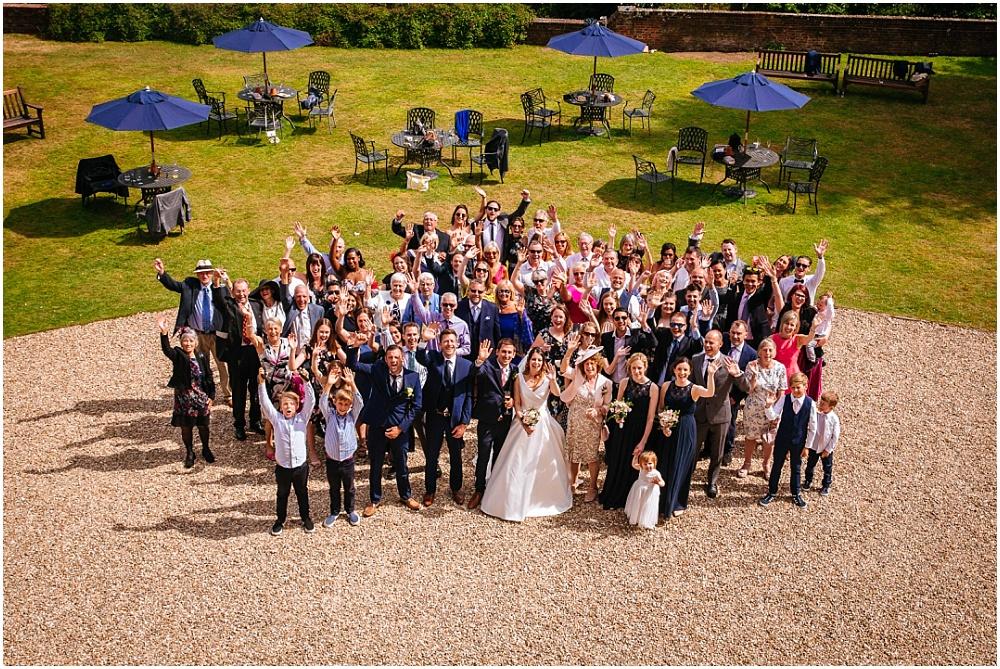 Shot of everyone at farnham castle wedding