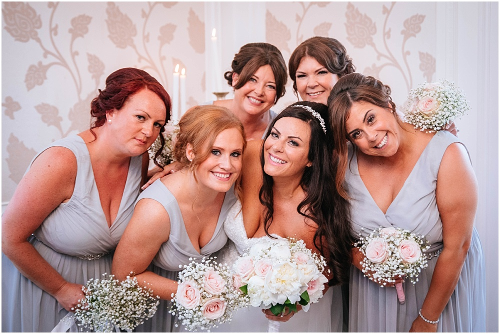 Bride and her bridesmaids inside at Froyle park