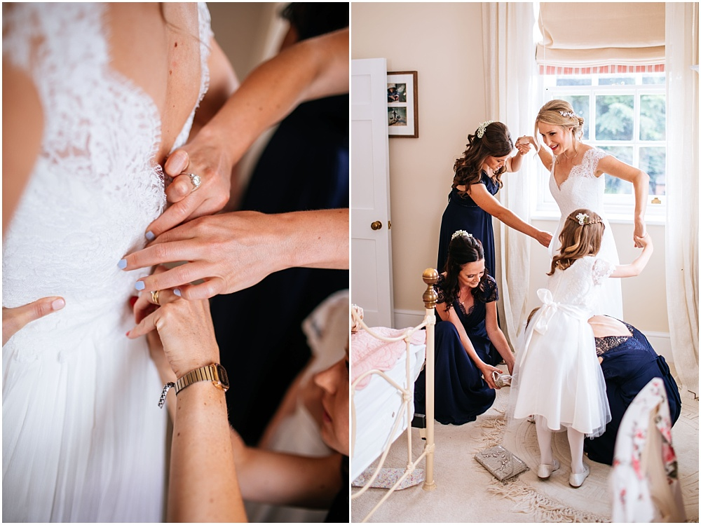 Bridesmaids help with the dress