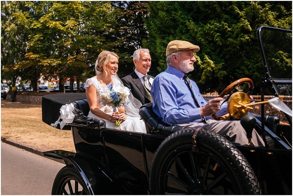Bride arrives in vintage car