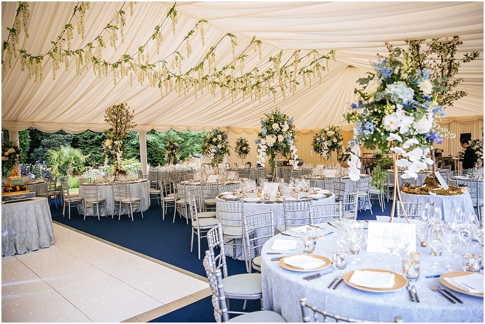 stunning marquee with blue table cloths