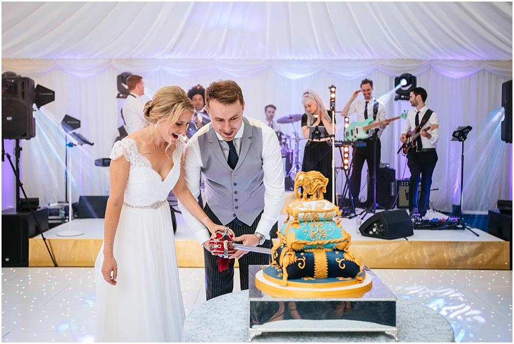cutting wedding cake with sword