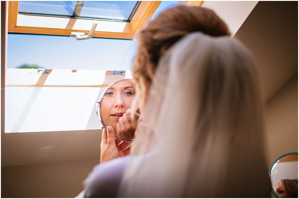 Bride doing own make up