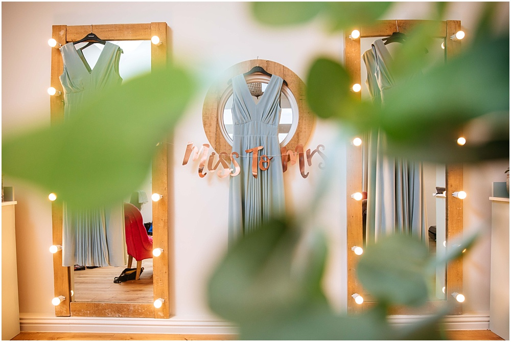 bridesmaid dress hanging up