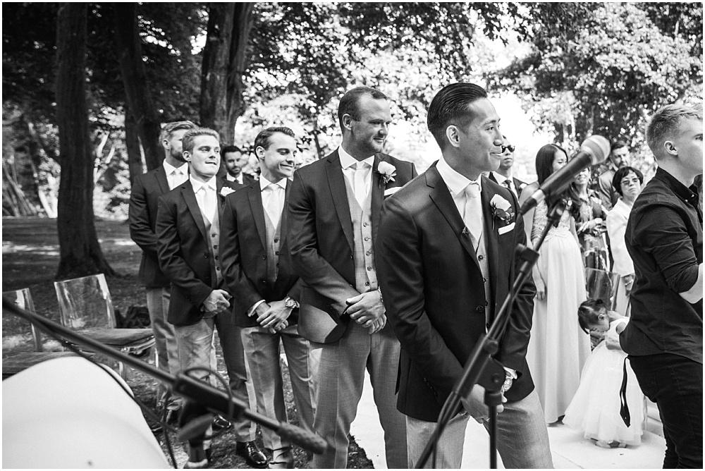 ushers watch the bride arrive