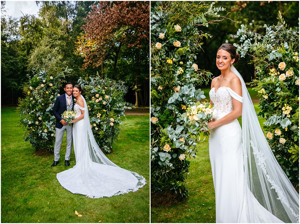 bride and puddled dress and non arch floral arch