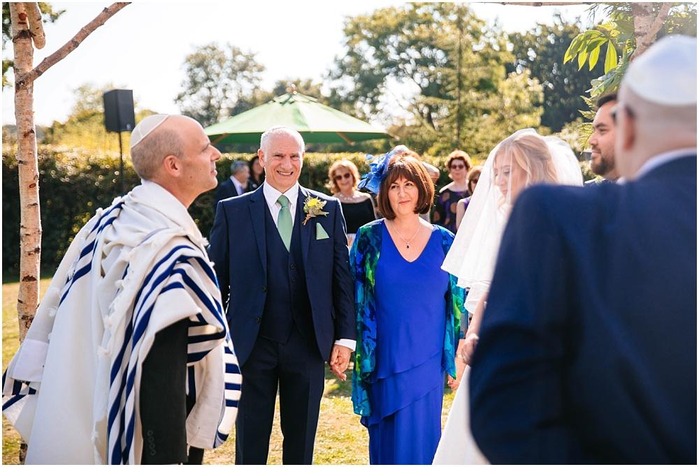 Brides parents watch ceremony