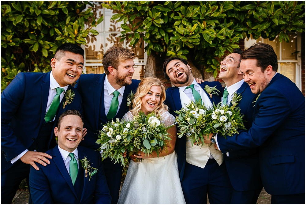 men holding wedding bouquet