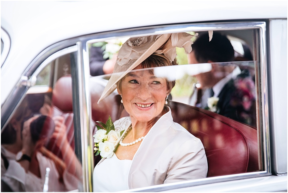 mother of bride arrives at church