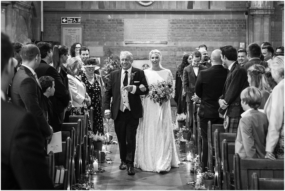 bride walking down the aisle in sunningdale chuch