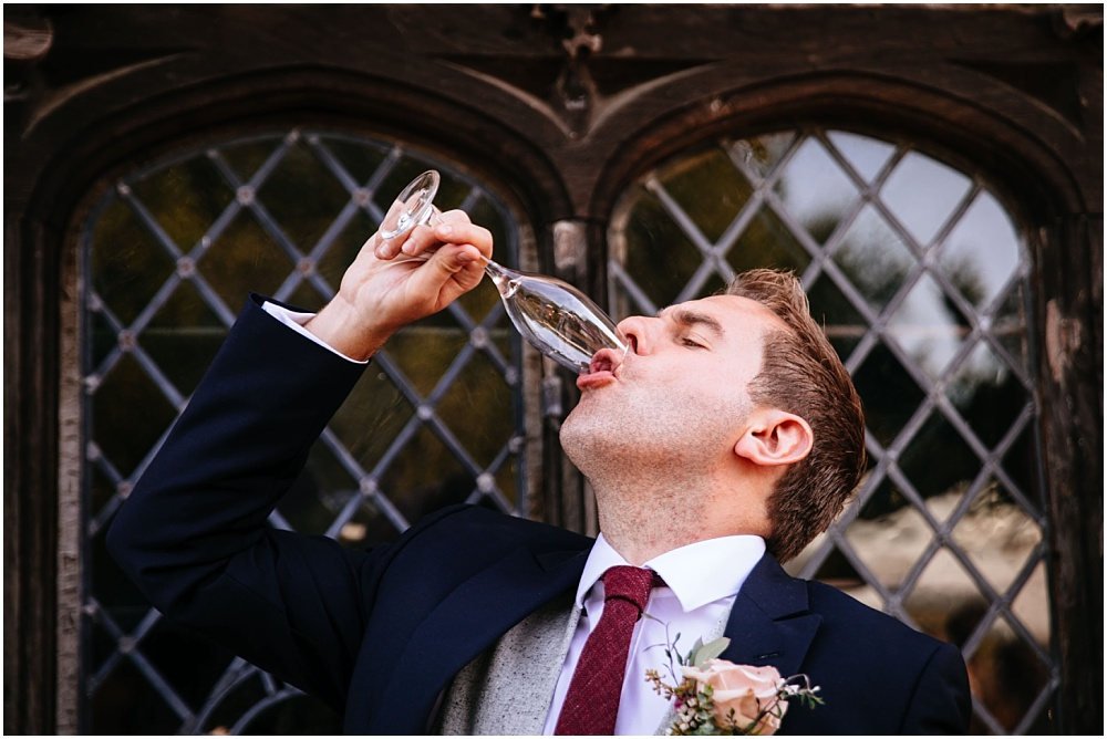 groom downing a drink