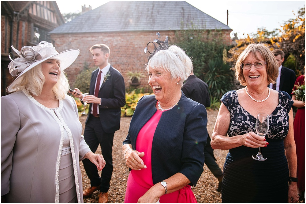 laughing wedding guests