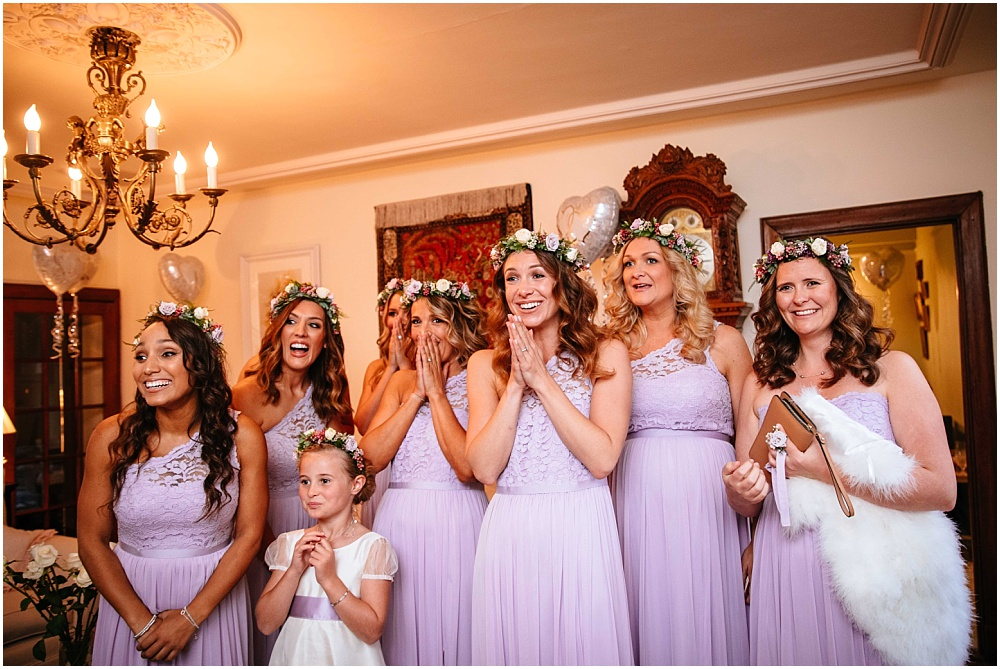 bridesmaids reacting to seeing bride for the first time