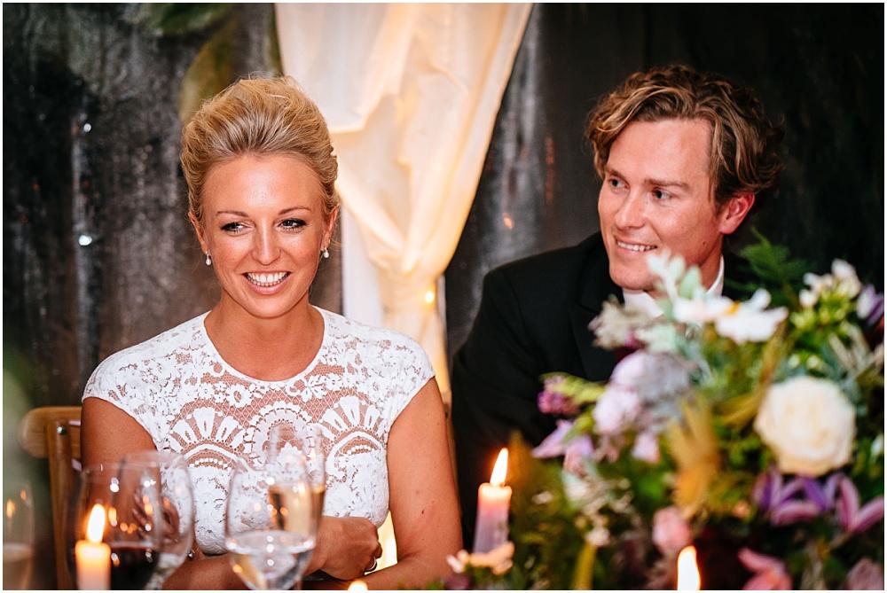groom gazes at pretty bride