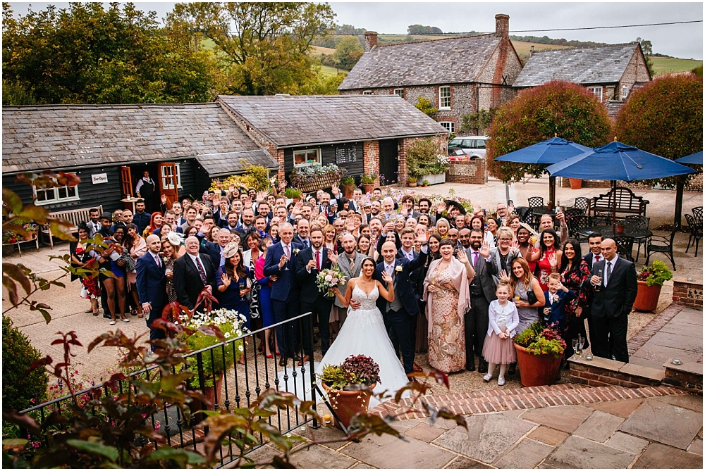 Big group shot of everyone at upwaltham barns wedding