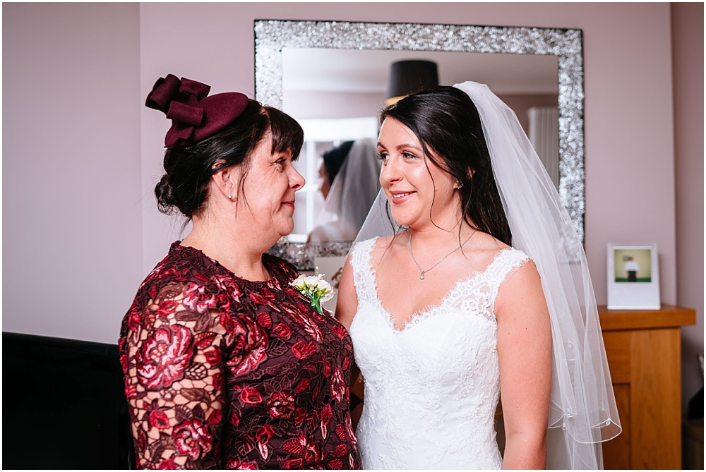 bride looks at mum