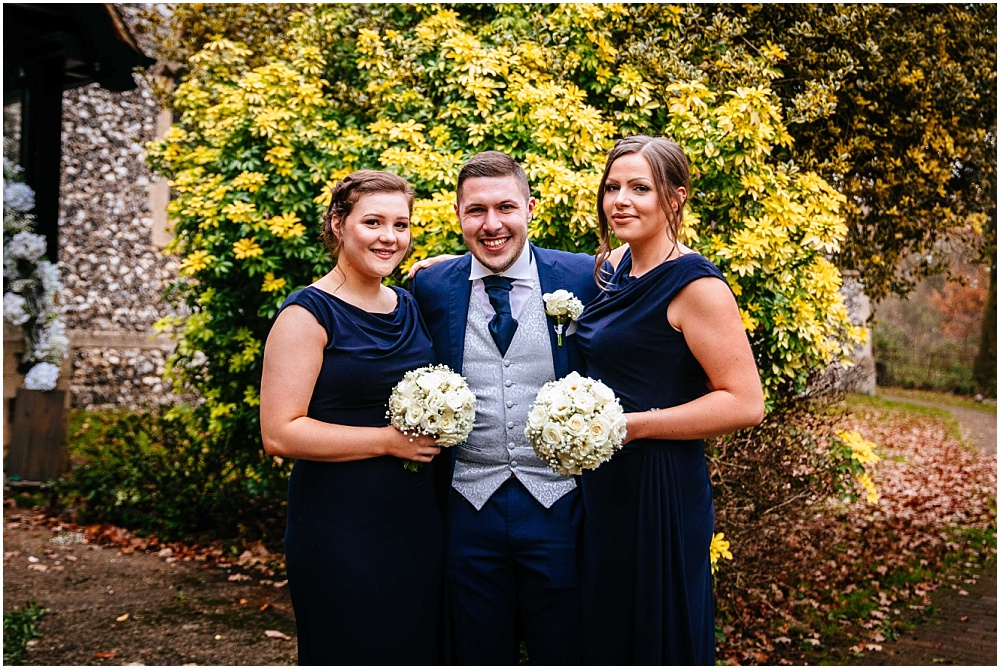 Groom and bridesmaids outside st mary church