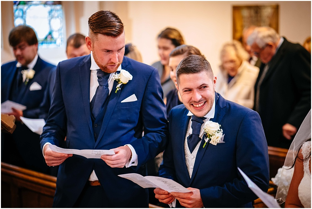 groom smiling during wedding ceremony at st marys