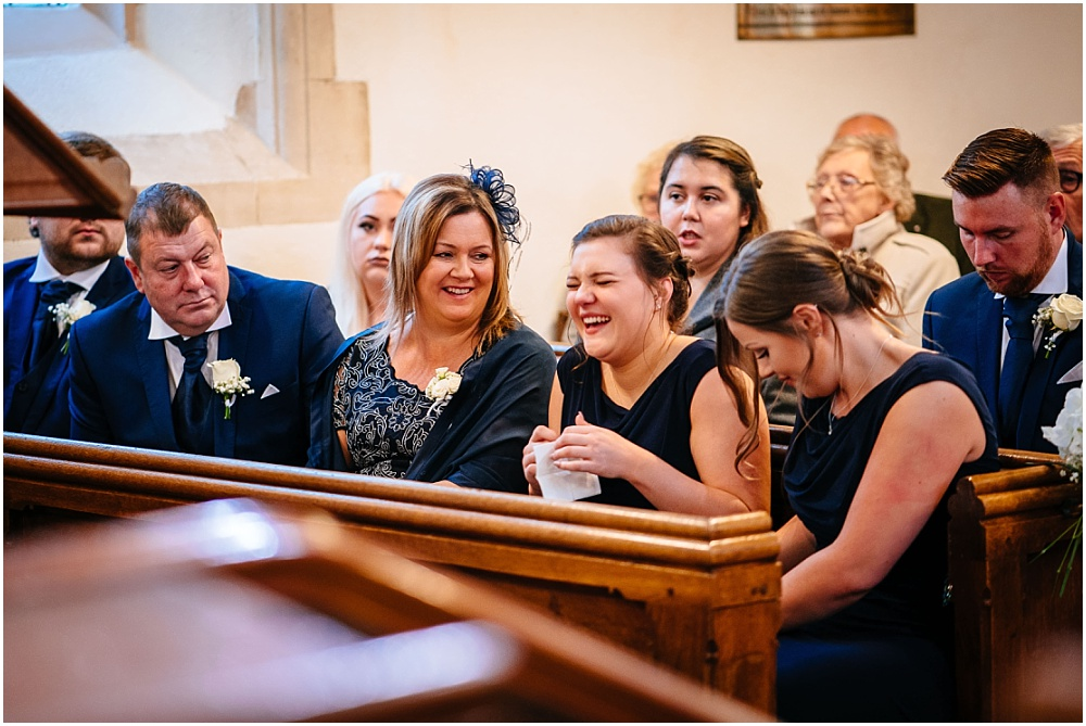 laughing during wedding ceremony