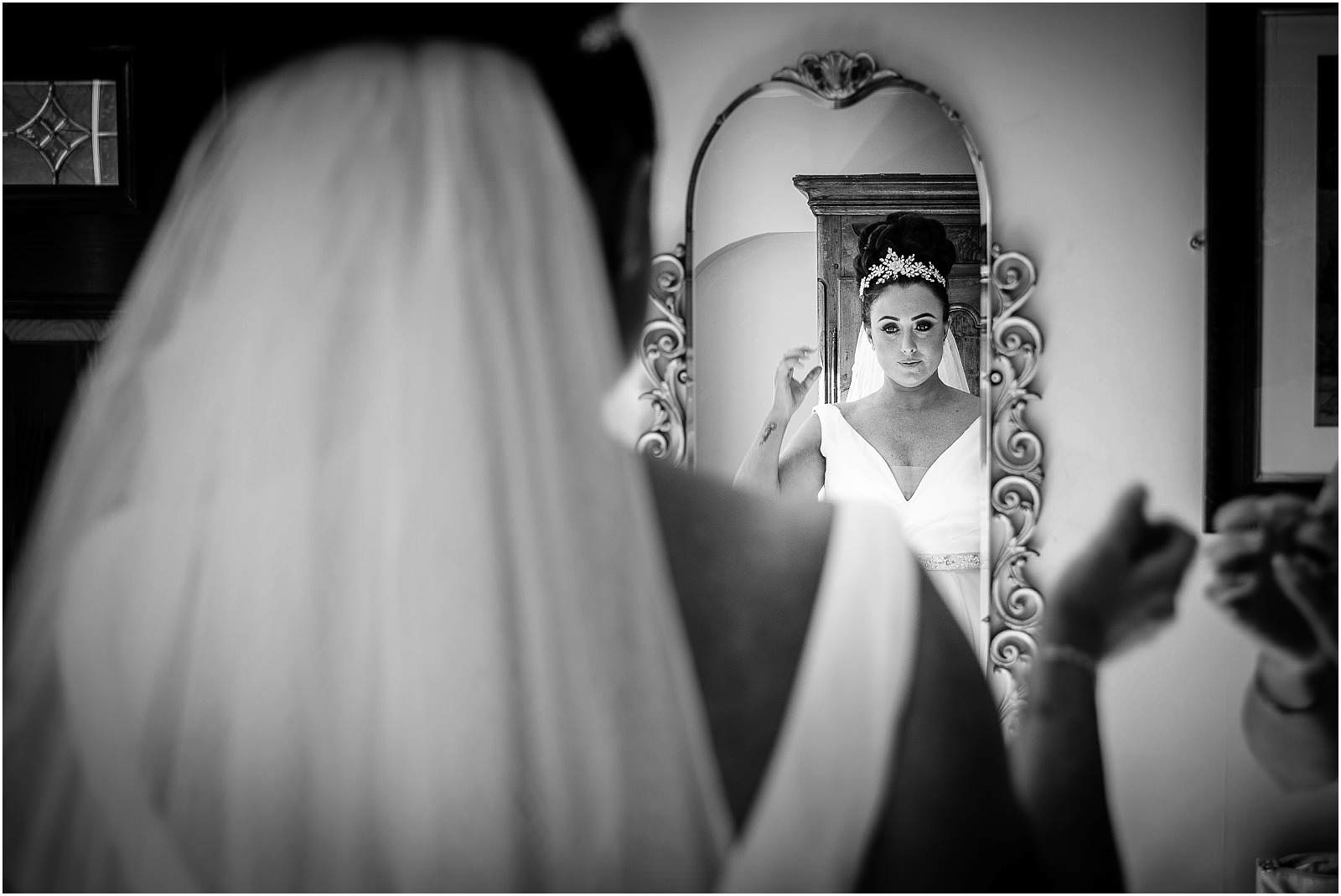 Bride checks reflection before kent wedding