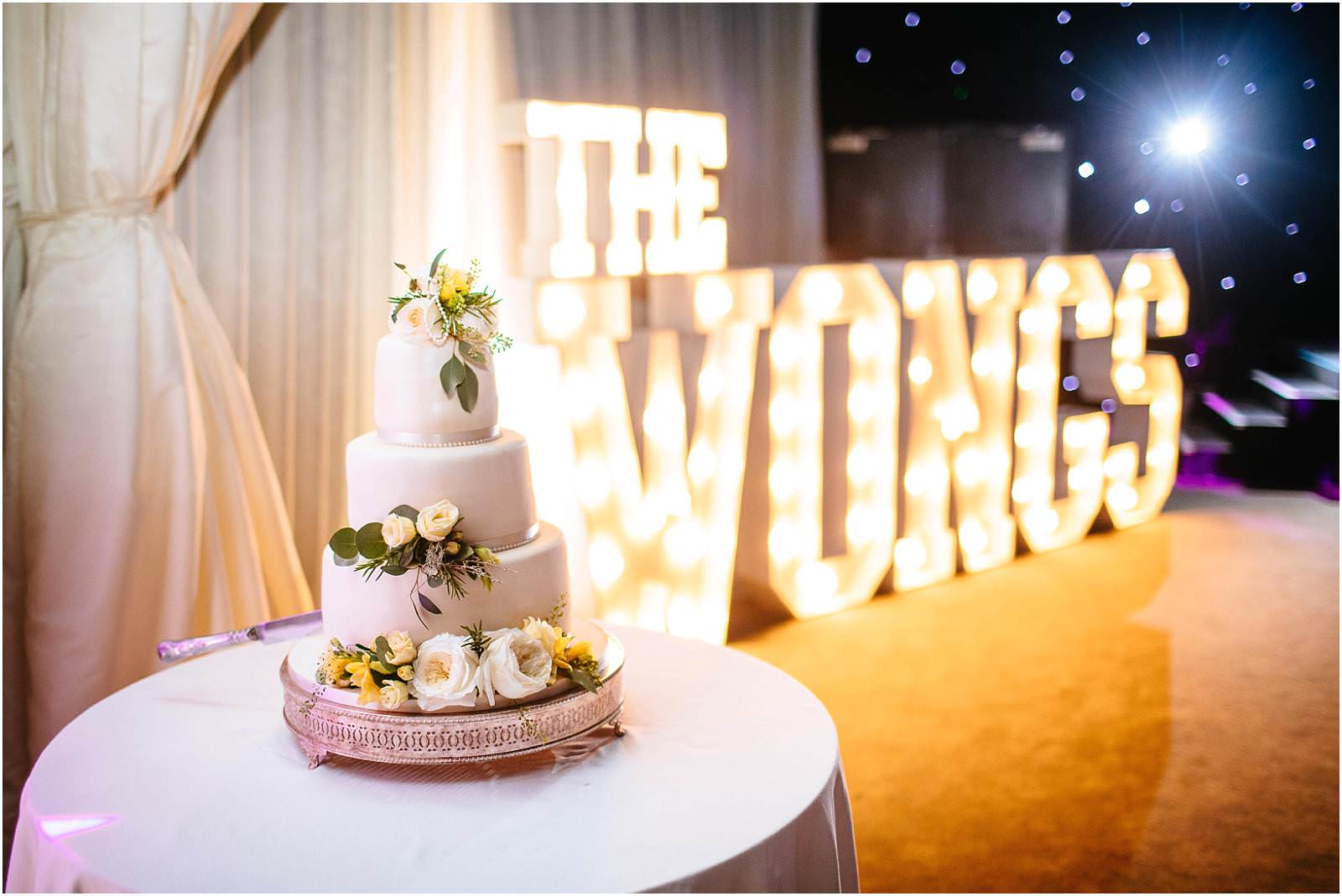 wedding cake and light up letters
